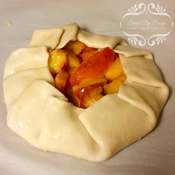 Peach tart ready to be baked