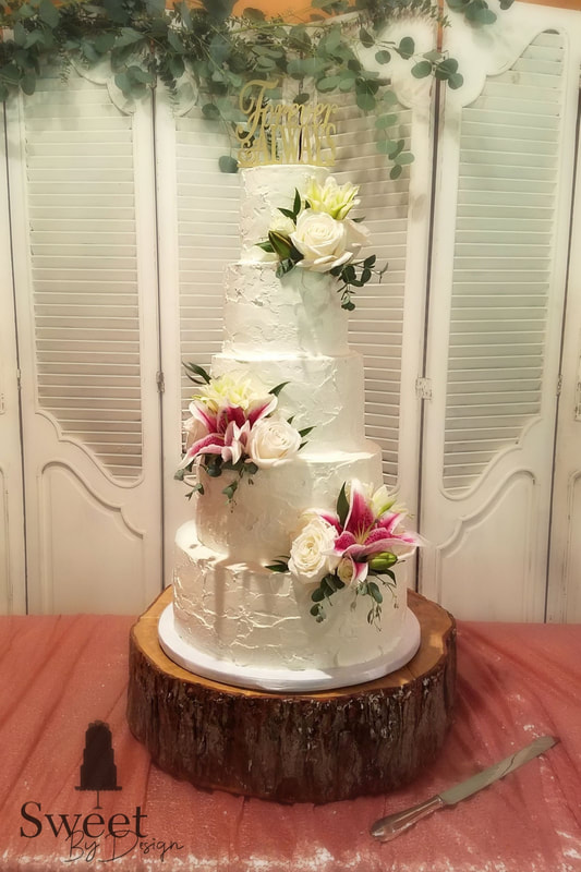 Rough textured wedding cake by Sweet By Design