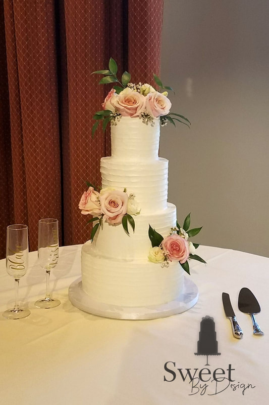 Classic buttercream texture wedding cake with fresh flowers by Sweet By Design