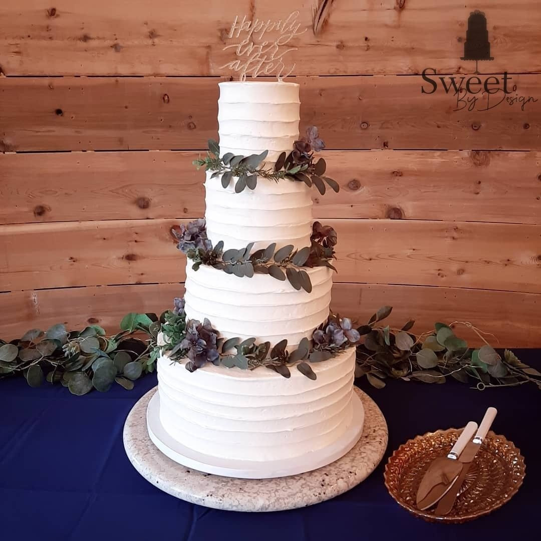 Textured wedding cake with greenery by Sweet By Design