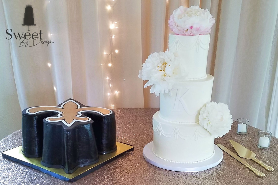 Traditional wedding cake and Saints groom's cake by Sweet By Design