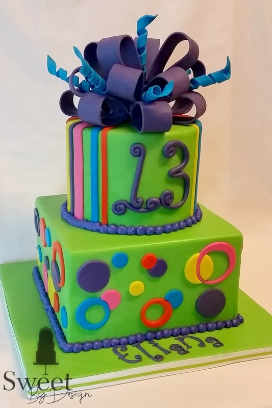 Fondant dots and stripes with a bow cake by Sweet By Design in Melissa, TX