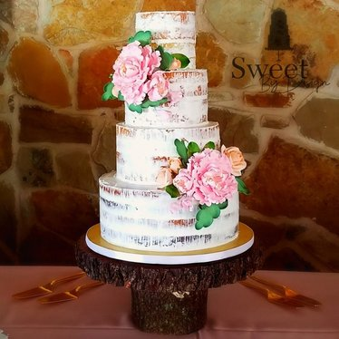 Naked wedding cake with fondant flowers by Sweet By Design in Melissa, TX