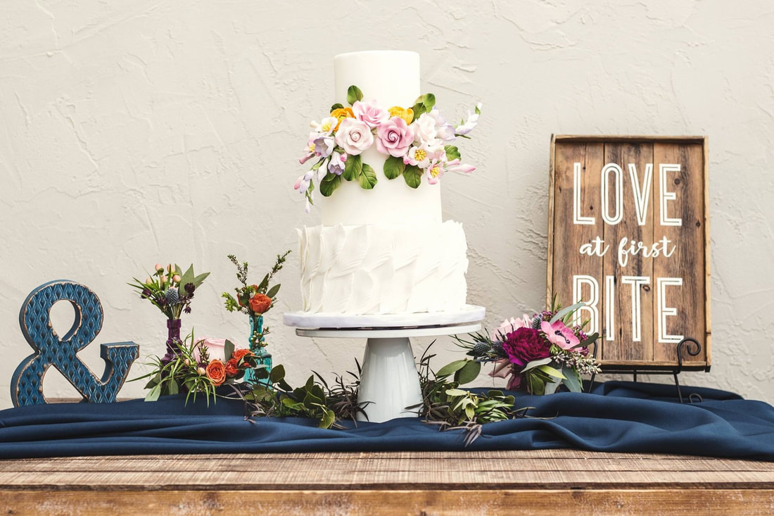 Fondant feather and flower wedding cake by Sweet By Design