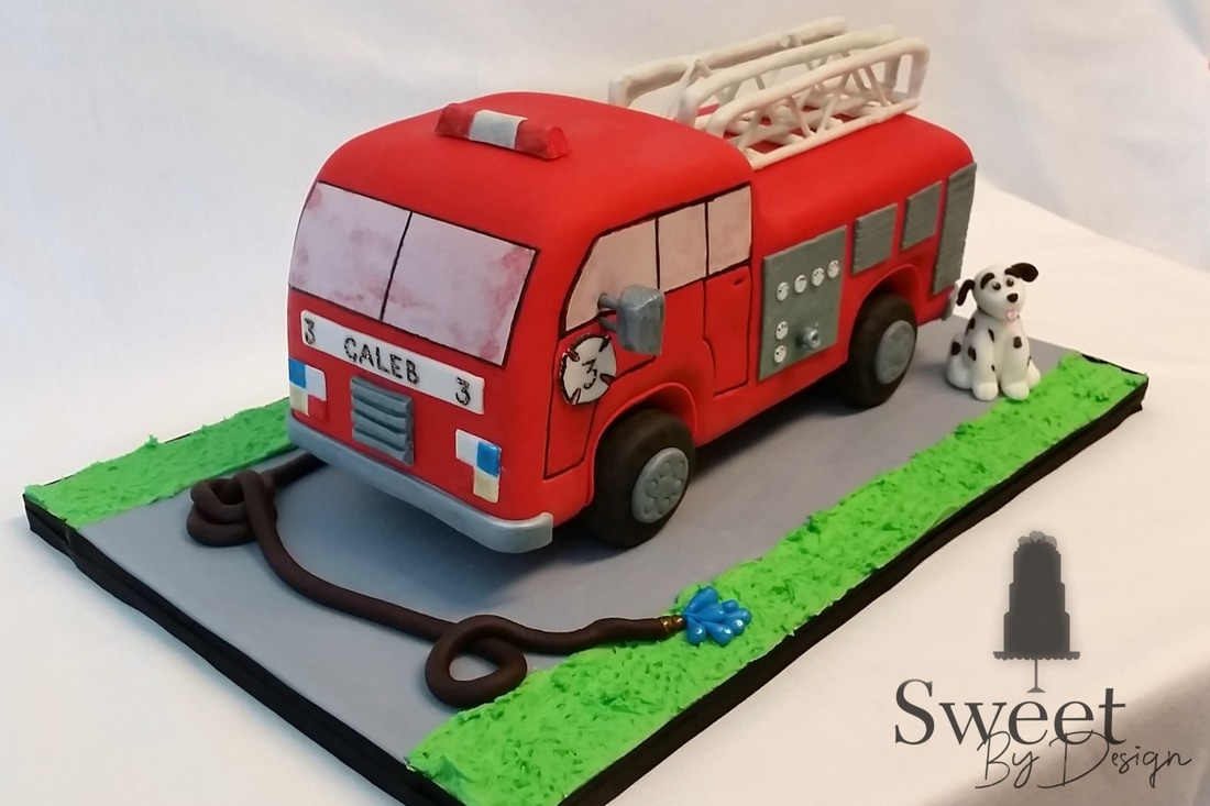 3D, carved firetruck cake by Sweet By Design in Melissa, TX