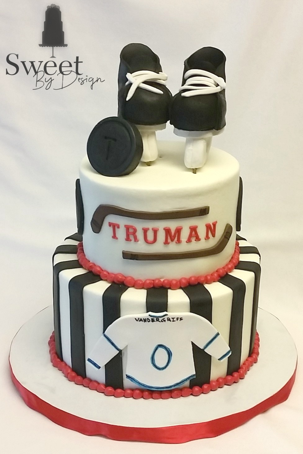 Hockey baby shower cake by Sweet By Design in Melissa, TX