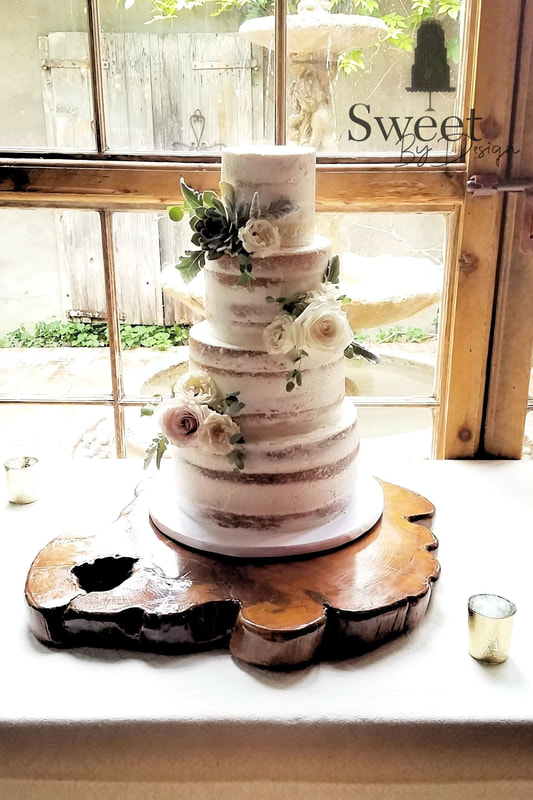 Naked wedding cake with roses and succulents by Sweet By Design