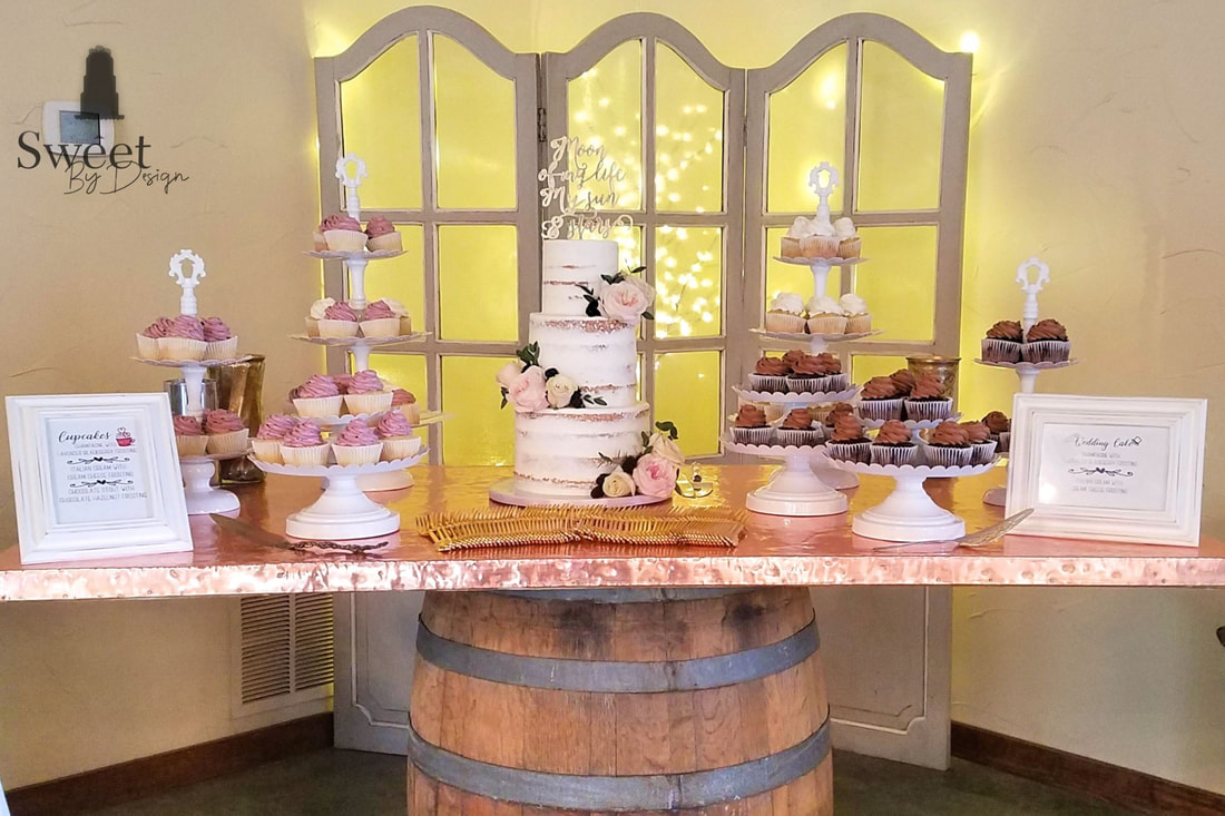 Semi iced wedding cake and cupcakes by Sweet By Design