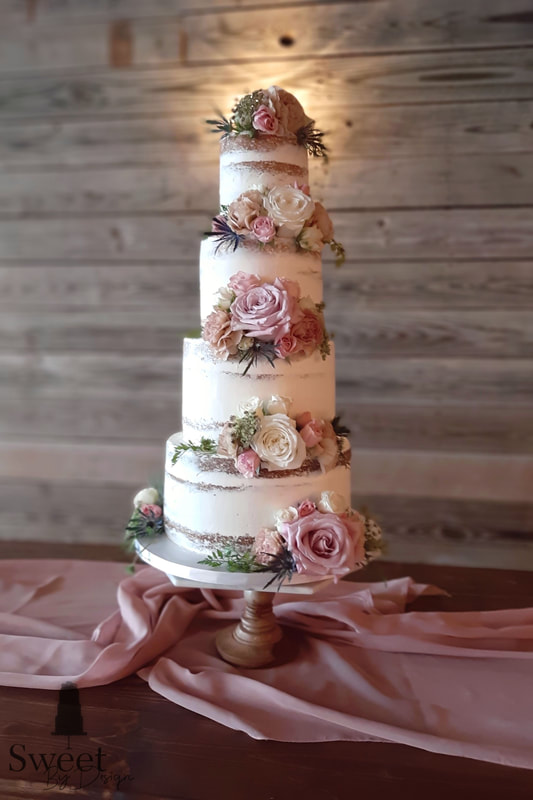 Naked wedding cake with fresh flowers by Sweet By Design