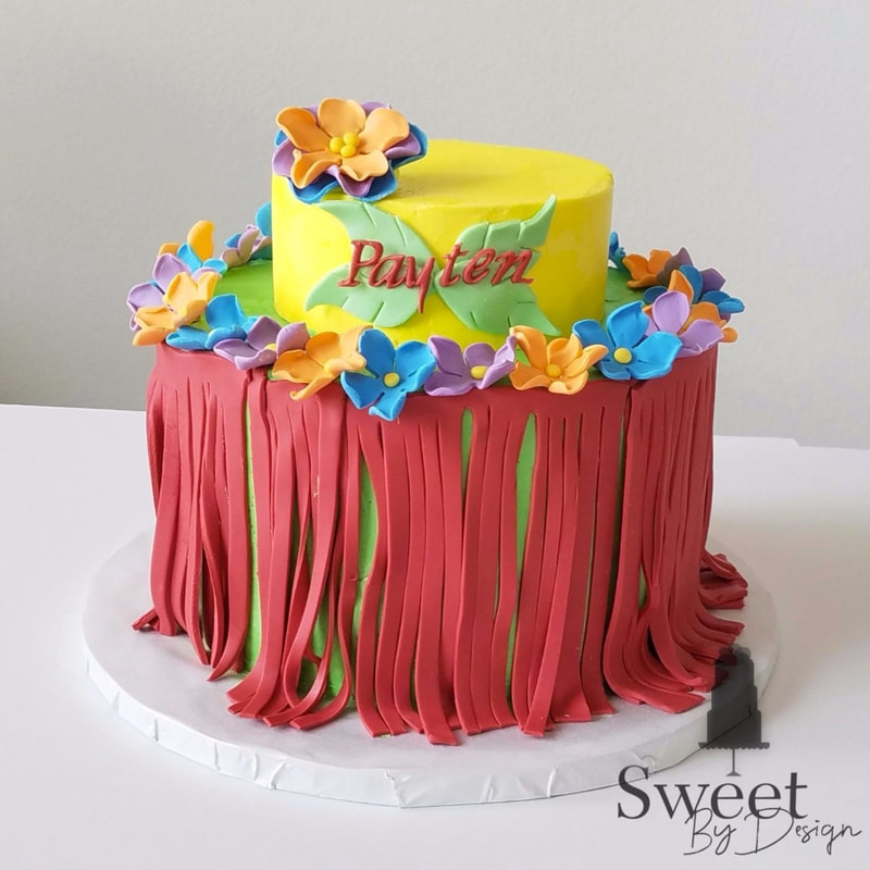 Tropical birthday cake with fondant flowers and hula skirt by Sweet By Design in Melissa, TX