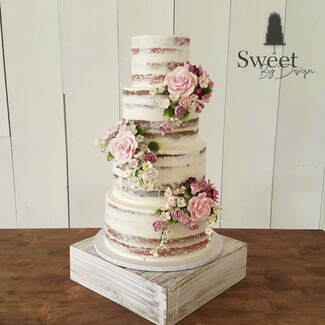 4 tier naked cake with fondant flowers by Sweet By Design in Melissa, TX