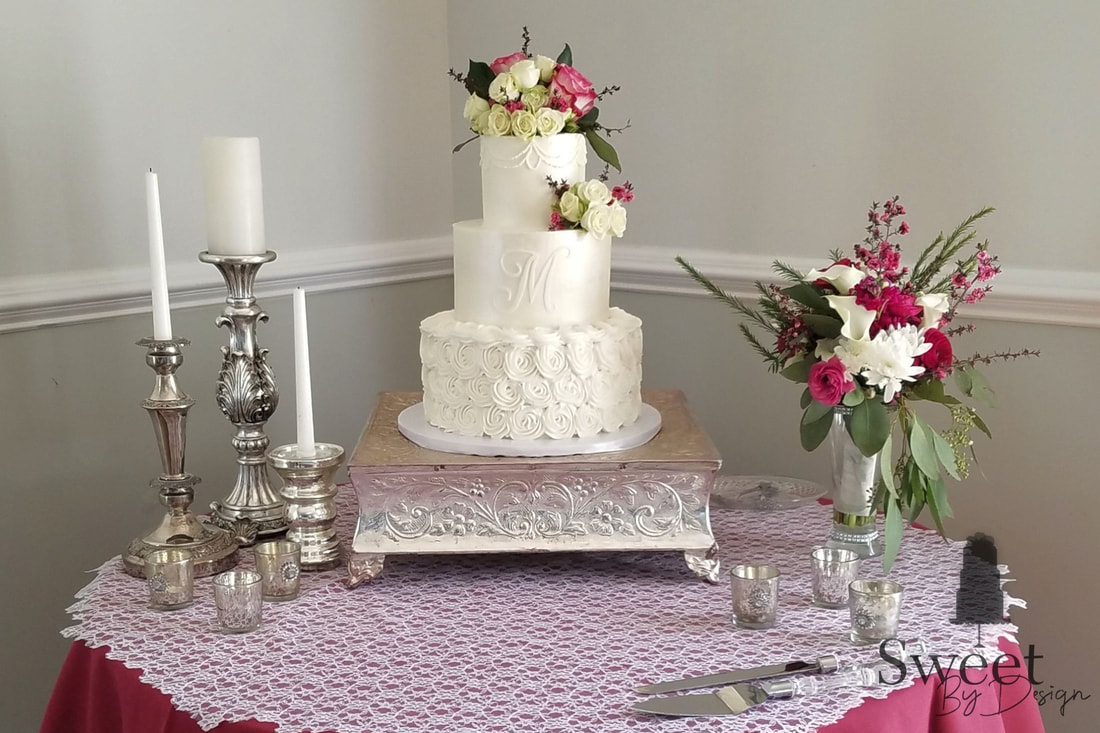 Buttercream wedding cake with monogram by Sweet By Design