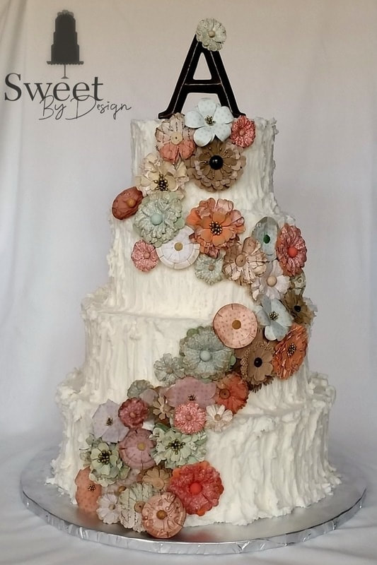 Vertical textured buttercream wedding cake with paper flowers by Sweet By Design