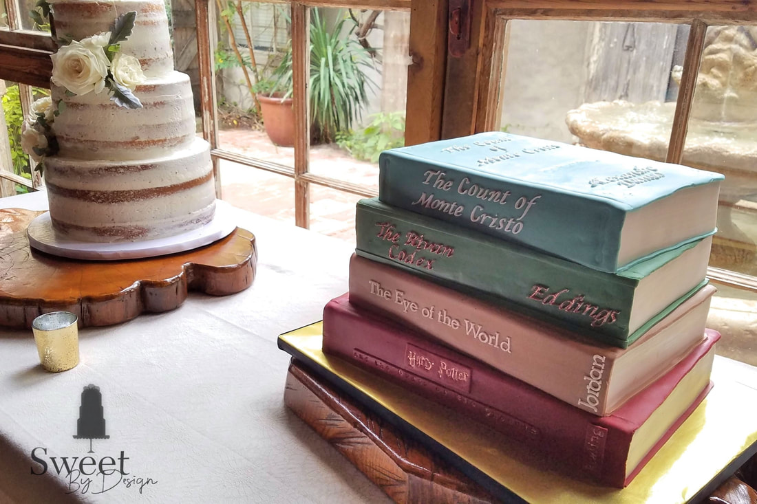 Stack of books groom's cake by Sweet By Design
