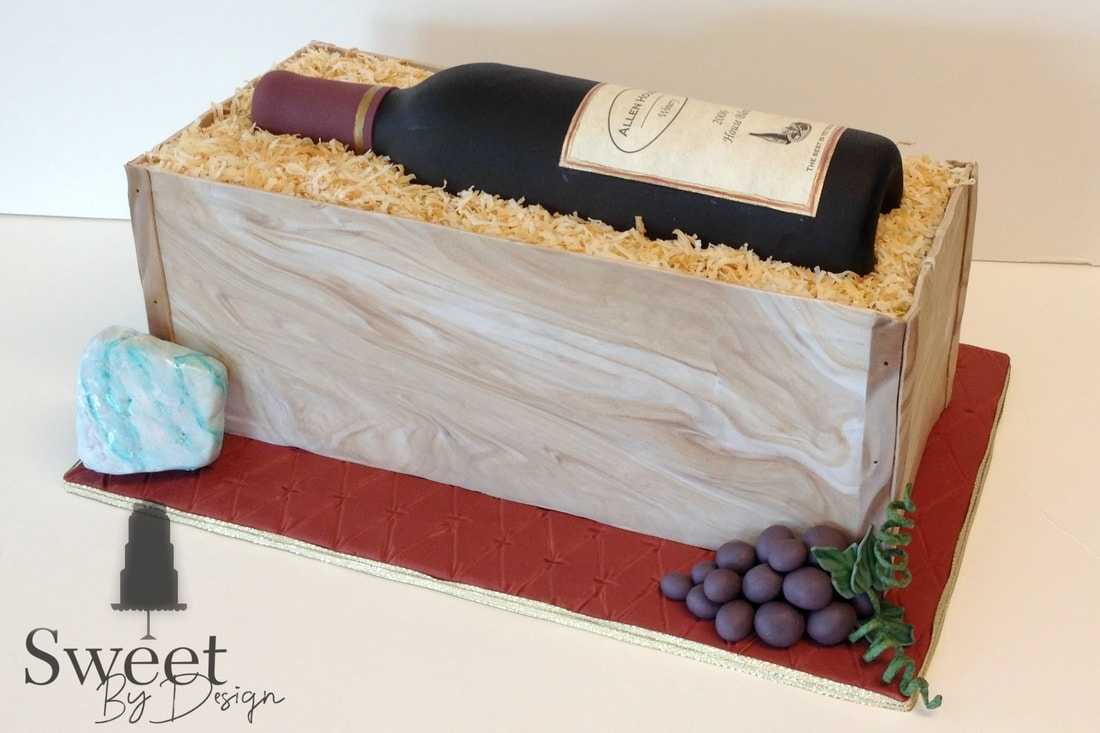 Wine bottle groom's cake by Sweet By Design